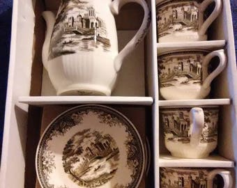 Vintage Homestead tea set.  Pitcher and 4 cups and saucers.