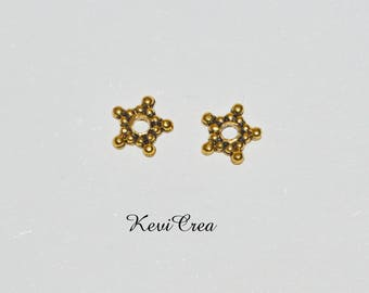 spacer beads 20 x star 8mm gold tone