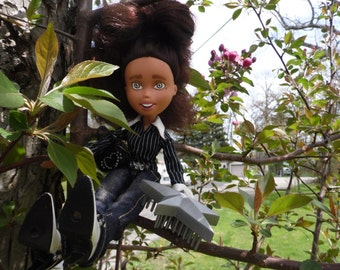 Bare Faced Dolls # 65 - Black hair- Grey eyes -  Pictured In Tree - Ooak - Repainted- Bratz Makeunder- Changed doll.