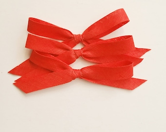 Vintage red hand tied bow