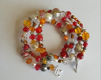 Bracelet 4 row memory wire - glass beads and acrylic shades of Red