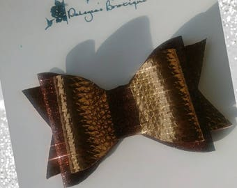 Brown and copper bow
