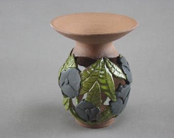 Wheel thrown vessel with carved leaves & flowers
