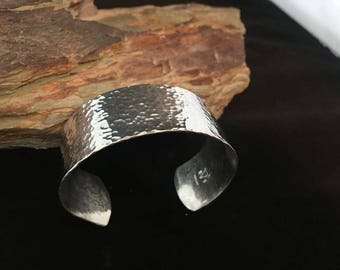 Wide sterling silver hammered cuff.