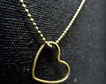 Heart and chain necklace with brass ball