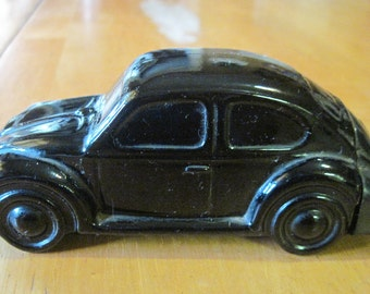 avon black vw bug beetle with label