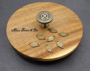 8 small bronze 1.5 x 0.90 diamond-shaped connectors cm