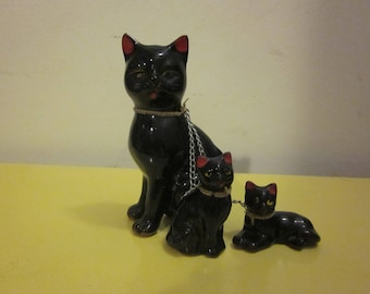 Vintage black redware cat with two kittens, with chain.