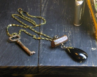 RENAISSANCE WOODS. Rustic wood branch bead, Black Glass and rusty skeleton key necklace