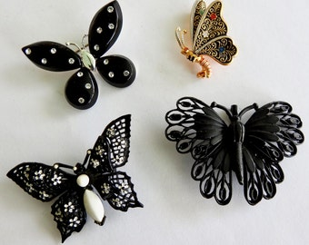 Four Black Butterfly Brooches