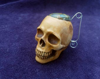 Skull box  made of yew tree with semiprecious stone cap.