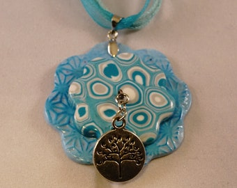 Turquoise blue polymer clay pendant necklace