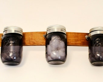 5 ball jars on a repurposed wine barrel stave for wall storage