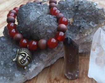 Carnelian bracelet with Buddha pendant
