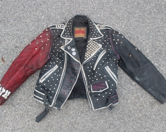 One of a kind vintage leather motorcycle jacket studded and painted punk grunge defiance cooper