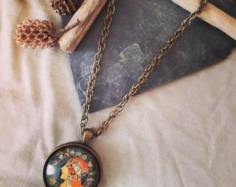 Bronze necklace vintage with the face of a Bohemian, showy behind her Zodiac symbol