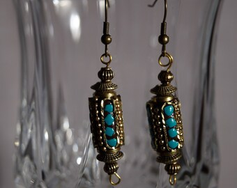 Brass and  turquoise color handmade earrings.