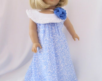 Sleeveless bubble dress in a sky blue floral print for 18 inch dolls