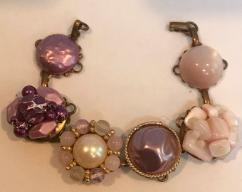 """Affordable Vintage, 1950's retro 7 1/2"""" bracelet in shades of pink earrings on a brass filigree base"""