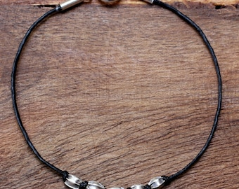 Waxed cotton cord bracelet with sterling silver beads and closure