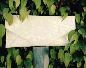 White Patent genuine leather, embossed in crocodile Clutch