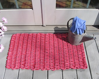Nantucket red handwoven doormat from lobster trap rope.
