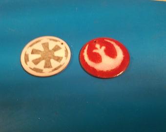Two Emblem Pendants