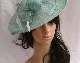 Deep Aqua Green Feather Fascinator..Stunning shaped Fascinator on a Headband..