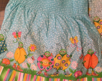 Colorful Lady Bugs & Butterflies Smocking Fabric