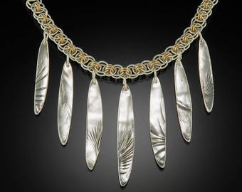 Feather textured fine silver pendant on sterling silver Byzantine chain