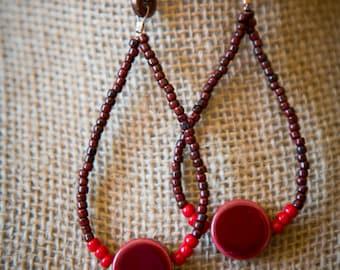 Dangling bead and ceramic earrings