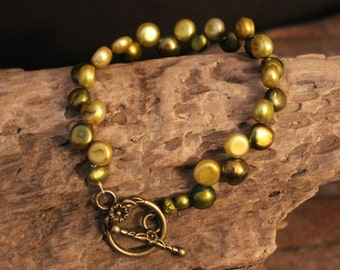 Such a Fun Quirky Green Beaded Bracelet with a Beautiful Decorative Bronze Toggle Clasp
