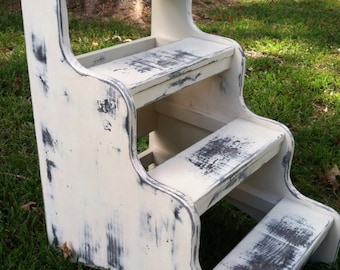 Step stair for dog or cat painted white distressed or paint to match your bedroom and not take up too much floor space