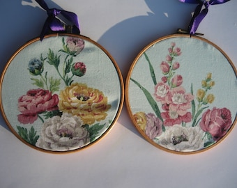 A pair of embroidery hoops with vintage flower fabric