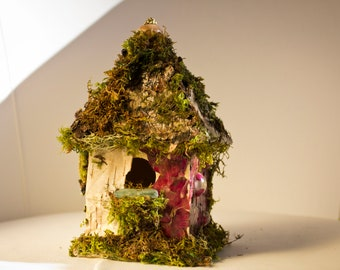Fairy cottage with moss bark and roses, fairy bird house