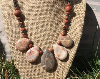 Teardrop shaped Picasso jasper necklace with gold stone and hematite