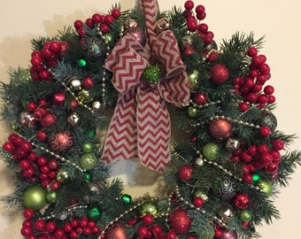 Burlap wreath with artificial greens and colorful ornaments sure to brighten your day