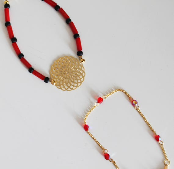 Double bracelet with filigree beads, red, black, and gold
