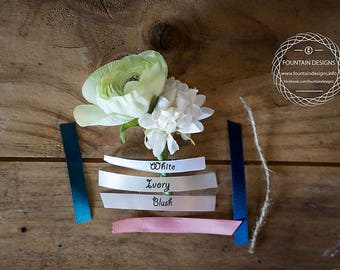 Green ranunculus and white dahlia boutonniere