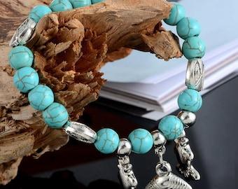 x 1 elastic bracelet beads turquoise/trinkets fish, shell, 19 cm