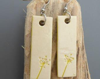 Dangling earrings made of ceramic, yellow flower print