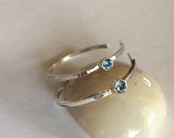 Textured hoop earrings, sterling silver with 4 mm tube set Blue Topaz.