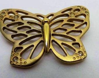 Gold butterfly brooch . Vintage Gold tone pierced butterfly brooch with diamante setting