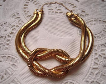 Novelty Love Knot Vintage Bracelet Goldtone Snake Chain with Safety Chain Hinged clasp 7 1/4 inches