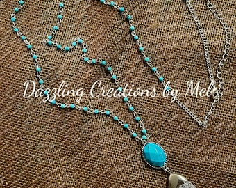 Turquoise bead chain necklace with turquoise tassle pendant.