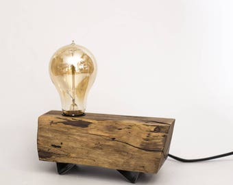 Walnut Wooden Lamp with black steel feet, black cloth power cord and Edison bulb