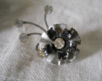 Vintage Flower Pin With Spray Of Rhinestones Flower With Silver And Black Petals Rhinestone Center Vintage Jewelry