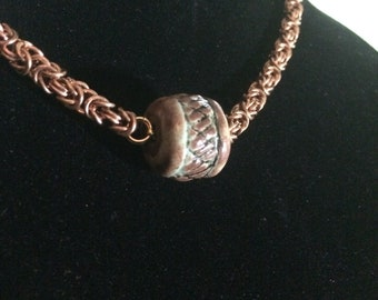 Hand-crafted ceramic bead on a bronze Byzantine weave chain.