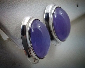 Oval amethyst cab earrings set in sterling silver.