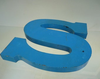 Large letter sturdy Impasto lacquered blue typography. Old sign vintage 30s or 40s